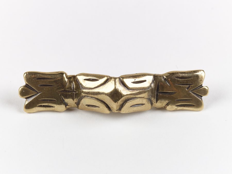 A reproduction ansate brooch