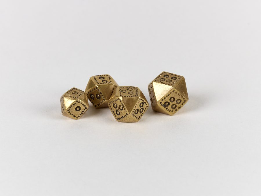 A group of four copper alloy, polyhedral weights