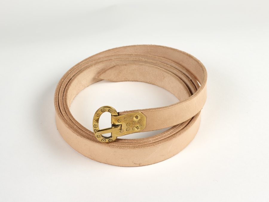 Leather belt with copper alloy buckle