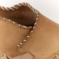 Detail of stitching on a shoe