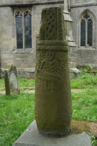 Stone cross-shaft depicting a warrior