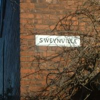 Sign on a house that reads Sweynville