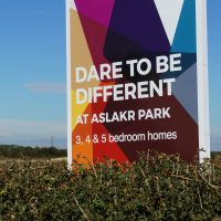 Advertising hoarding for Aslakr Park in Aslockton