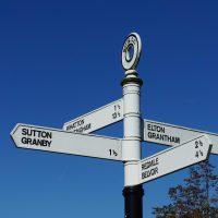 Signpost showing Sutton, Granby, Whatton, Nottingham, Elton, Grantham, Redmile, Belvoir