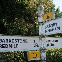 Signpost showing Barkestone, Redmile, Granby, Bingham, Stathern, Harby