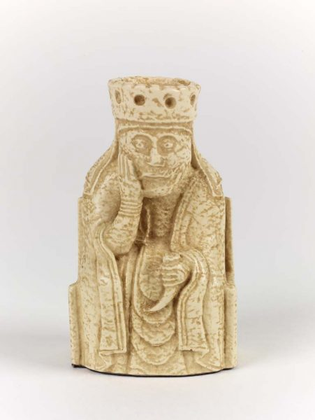 A reproduction of a queen piece for chess found at Lewis.