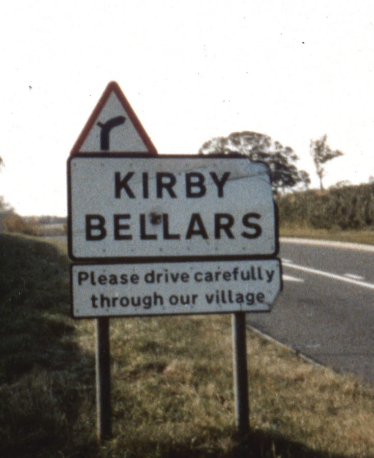 Village sign showing the name Kirby Bellars