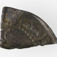 An unidentified silver dirham fragment found in Torksey, Lincolnshire. © The Fitzwilliam Museum, Cambridge