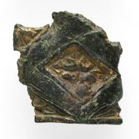 A broken gilt vessel fragment decorated with Carolingian motif found in Torksey, Lincolnshire. © The Fitzwilliam Museum, Cambridge