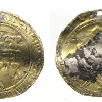 Samanid silver dirham made into a gilded pendant (c) Lincolnshire County Council