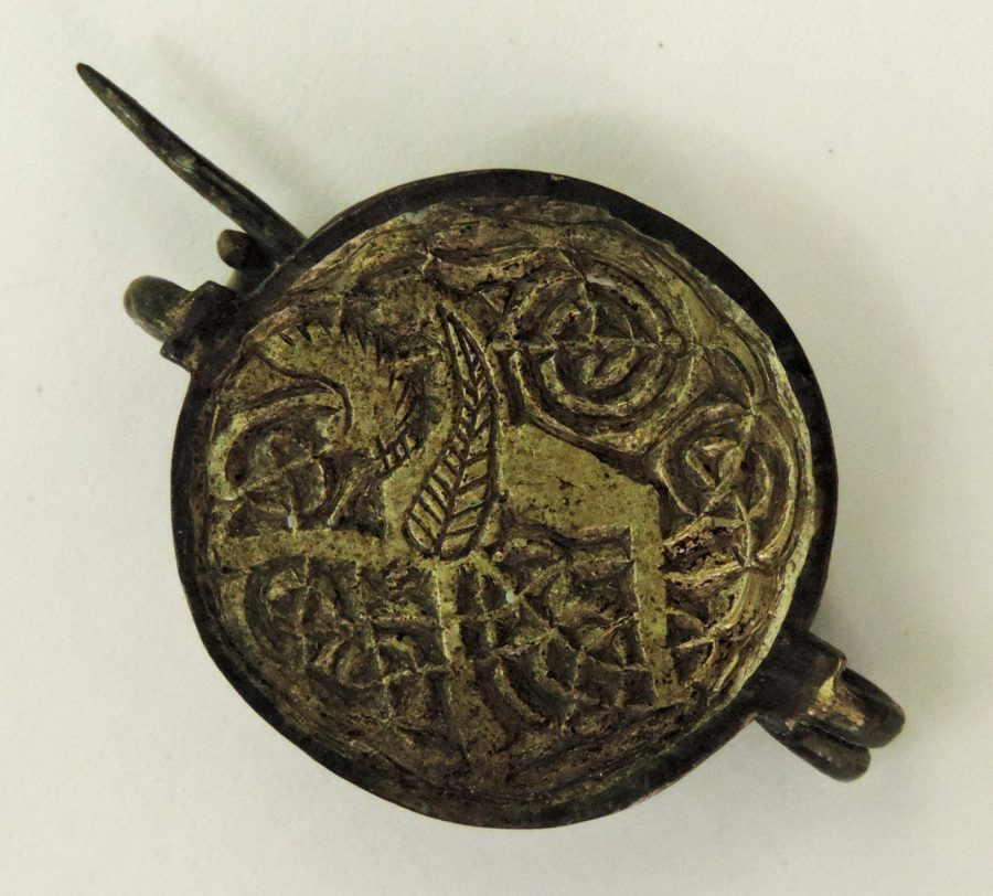 A silver gilt brooch depicting a griffin found in Repton, Derbyshire. (c) Derby Museum and Art Gallery