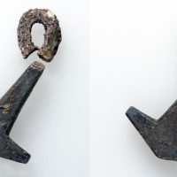 Front and reverse of a Thor's hammer pendant. (c) Derby Museums 2019