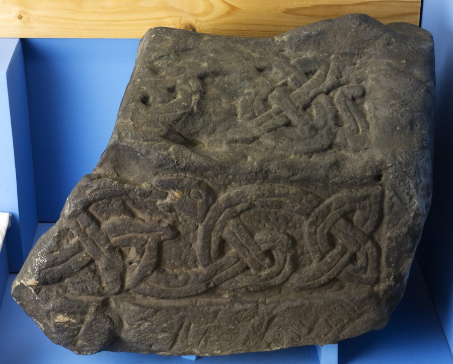 Fragment of a recumbent grave marker from St Alkmund's Church, Derby. (c) Derby Museums 2019