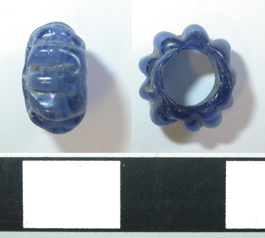 A blue glass bead from the Magistrates Court site, Derby, Derbyshire. (c) Derby Museum and Art Gallery