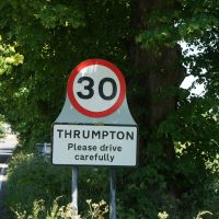 Village sign showing the place-name Thrumpton, in Nottinghamshire