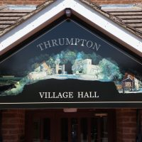 Entrance sign for the village hall in Thrumpton, Nottinghamshire.